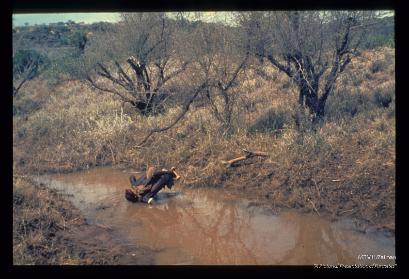 A man drinking polluted water. Ethiopia.